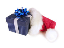 Santa Hat with Gift. Santa Claus hat with blue pin-striped gift Royalty Free Stock Photo