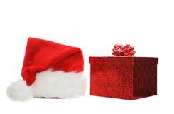Santa hat and gift Royalty Free Stock Photos