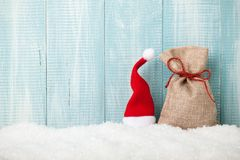 Santa hat and gift bag on snow. Copy space Stock Photography