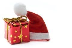 Santa hat and gift box Royalty Free Stock Images