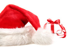Santa hat and gift with red bow Royalty Free Stock Images