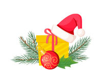 Santa Hat on Giftbox near Evergreen Christmas Tree Royalty Free Stock Photo