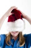 Santa hat and girl Royalty Free Stock Photo
