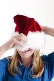 Santa hat and girl Royalty Free Stock Photography