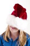 Santa hat and girl Royalty Free Stock Image