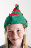 Santa hat and girl Stock Photography