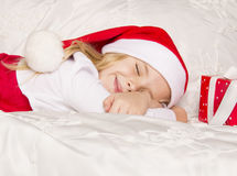 Santa hat girl dreams Stock Photos