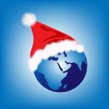 Santa hat on globe. Earth globe with Santa hat Stock Image
