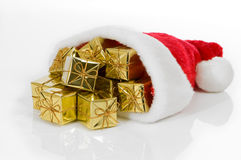 Santa Hat With Gold Presents Royalty Free Stock Image