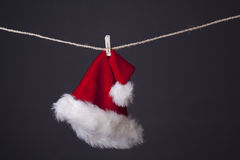Santa hat hanging  on grey Stock Photography