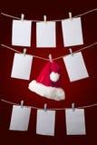 Santa hat hanging  on grey Stock Image
