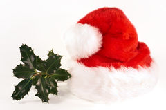 Santa hat and holly Royalty Free Stock Photos