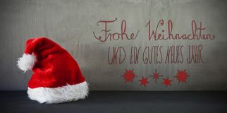 Santa Hat, Kalligraphie Frohe Weihnachten bedeutet frohe Weihnachten Stockbild