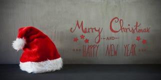 Santa Hat, Kalligraphie-frohe Weihnachten und guten Rutsch ins Neue Jahr Stockbilder