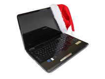 Santa hat on a laptop Royalty Free Stock Photos