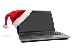 Santa Hat on a Laptop Royalty Free Stock Image