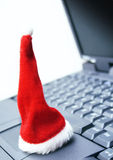 Santa hat on laptop royalty free stock image