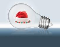 Santa hat in a light bulb. Royalty Free Stock Photos