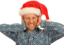 Santa hat man covering ears Stock Photo