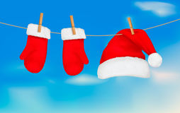 Santa hat and mittens hanging. Stock Photography