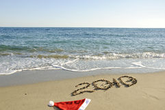 Santa hat and New Year on the beach. Royalty Free Stock Images