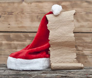 Santa hat and old paper scroll Royalty Free Stock Images