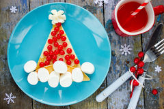 Santa hat pancake for breakfast - Christmas and New Year fun foo Royalty Free Stock Images