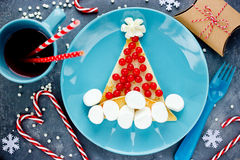 Santa hat pancake for breakfast - Christmas and New Year fun foo Royalty Free Stock Photos