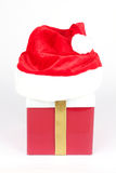 Santa hat on present box Royalty Free Stock Images