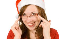Santa with hat and red specs. Young cheerful girl with santa hat and red glasses Stock Photos