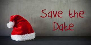 Santa Hat, risparmi del testo la data Fotografia Stock