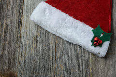 Santa Hat on Rustic Wood Royalty Free Stock Images