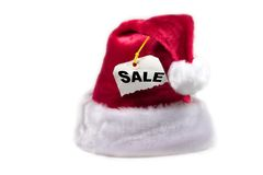 Santa hat with a sale tag. Isolated Santa hat with a SALE tag attached Royalty Free Stock Photos