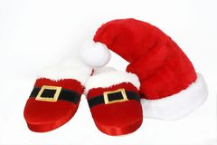 Santa hat and slippers Stock Photo