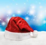 Santa hat on snow Royalty Free Stock Photography