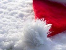 Santa hat on snow Stock Photo