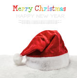 Santa hat on snow isolated on white background Royalty Free Stock Image
