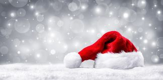 Santa Hat On Snow And Silver Shiny Stock Images