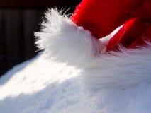 Santa hat on snow Stock Photography