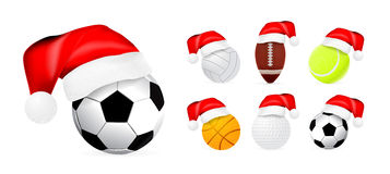 Santa hat on sport balls. Isolated on white background Royalty Free Stock Photo