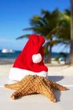 Santa hat and starfish on beach. Caribbean royalty free stock photo