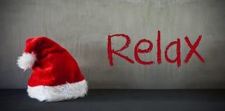Santa Hat, texte détendent, Gray Cement Background image libre de droits