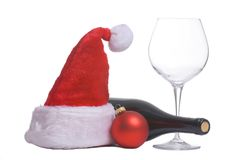 Santa hat and wine. A bottle of christmas wine, complete with a santa hat Stock Image
