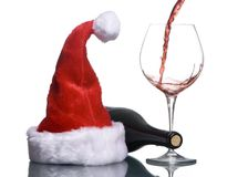 Santa Hat and Wine 2. A glass of red wine is poured next to a red santa hat Stock Photos