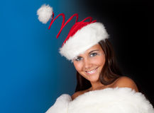 Santa hat on winter girl Royalty Free Stock Image