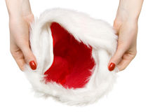 Santa hat in woman hands Royalty Free Stock Image