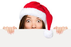 Santa hat woman showing christmas sign Royalty Free Stock Photography