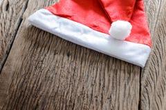 Santa hat on wooden Stock Image