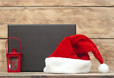Santa hat and wooden plate Stock Images