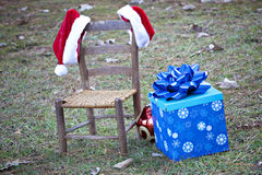 Santa hats hanging on empty chair Stock Photography